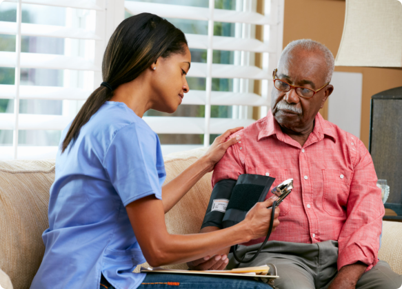 an elderly man with his blood pressure check-up