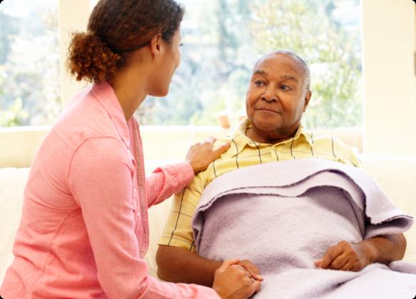 an elderly talking to a man