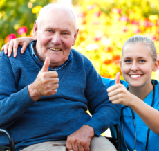 an elderly man and his caregiver